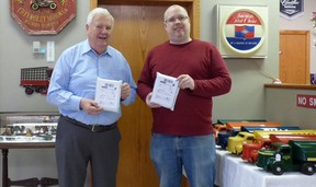 Rotarian Ken McGee (left) and his employee and packaging expert Josh Middelkamp, at Ken's shop. They sent two of the Rotary fundraiser puzzles to the two Canadian Michaels imprisoned in China. Rotary supplied the puzzles and Ken donated the postings. Submitted