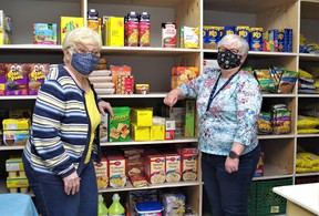 Food bank coordinator Sally McCharles, left, and assistant Diane Cole say there would be no food bank in Powassan without the help of volunteers and generosity of community members. Rocco Frangione Photo