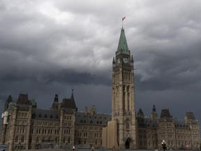 Storm clouds pass by the Peace tower and Parliament Hill on Aug. 18, 2020.