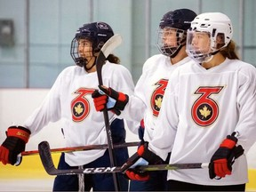 Burford's Emma Woods (right) and her Toronto Six teammates at a recent practice. The Six and the rest of the teams in the National Women's Hockey League will play their season starting next month.