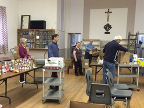 Some of the volunteers at work during a previous edition of the Lancaster Food Bank effort led by the Knights of Columbus. This year, because of the pandemic, only cash donations are being accepted.Handout//Cornwall Standard-Freeholder/Postmedia Network