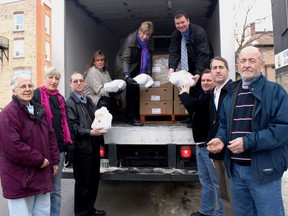 Many hands made light work as volunteers and donors unloaded 60 turkeys donated by the team from Bickerton Brokers Real Estate in Gananoque to the Food Bank at their location on King Street East in Gananoque back in 2010. L-r, Audrey Jackson, Whitney Kilgore, Bill Helmer, Judy Clark, Emily Bell, Mark Kellogg, Dave Redmond, Dwayne Fletcher and Cliff Weir. Lorraine Payette/For Postmedia Network