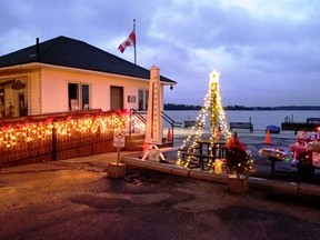 The Customs Dock in Rockport came alive with light and colour as the Friends of Rockport Customs presented its drive by gate lighting and fundraising dinner on December 4.   Supplied by Janet Gaylord