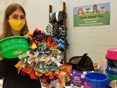 Hanover teen Olivia Schlosser with some items she hopes to sell under her new business, Mutts About You, at the Holiday Student Makers Market Saturday in the former Sydenham Community School building in Owen Sound. (Scott Dunn/The Sun Times/Postmedia Network)