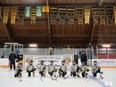 A Langton and Area Minor Hockey Association novice team under some of of the many LAMHA OMHA, Southern Councies and Silver Stick banners. (Chris Abbott/Norfolk and Tillsonburg News)
