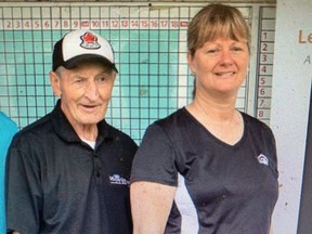 Walter Gretzky with June Dobson. Dobson, 58, a commanding officer at the Ontario Provincial Police (OPP) detachment in Grenville, has been charged with fraud over $5,000 and breach of trust over a hockey stick the Wayne Gretzky used during his playing days as a child in Brantford that was sold to a collector for $6,000.