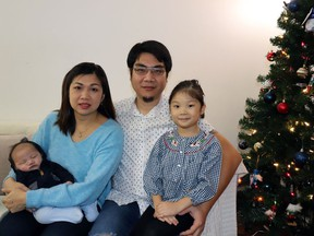 Daniel Muljarahardja and Saraswati Djojorahardjo,  pose with their daughter, Madeline, and infant son Marcellinus. He needs medical treatment that is available at a high cost in the United States.