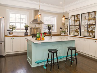 New cabinets and quartz countertops are features of the kitchen and Dan and Carol Lyn Brown's home on Sheridan Street in Brantford. The house is a replica, at least on the outside, of the historic Mackenzie House in Toronto, the last home of William Lyon Mackenzie. Brian Thompson/Brantford Expositor/Postmedia Network