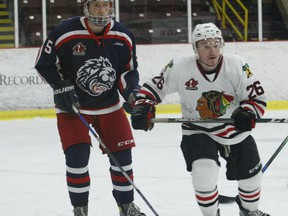 Former teammates Ben Dirven (left) and Troy Bowditch react to the play near the Cornwall net during a Colts-Braves scrimmage at the Brockville Memorial Centre in December.  File photo/The Recorder and Times