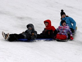 From left, Ethan Larocque, Adam Cook, Renee Cook and Norah Cook enjoy a slide down Laurier Hill on an increasingly rainy Monday morning. While the toboggan hill remains one of the few amenities people can enjoy durintg the lockdown, Monday's weather was quickly making sledding less of an option. (RONALD ZAJAC/The Recorder and Times)