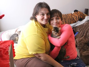 Amanda Craig and her 10-year-old daughter Angellica, on the futon just inside the front door at the small apartment they just moved into. Photo on Thursday, Dec. 17, 2020, in Cornwall, Ont. Todd Hambleton/Cornwall Standard-Freeholder/Postmedia Network