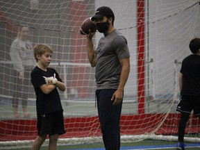 Coach Nate Behar with some instructions for Bryce Camplin at the Formula 11 Cornwall Wildcats camp. Photo on Sunday, December 20, 2020,  in Cornwall, Ont. Todd Hambleton/Cornwall Standard-Freeholder/Postmedia Network