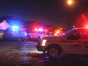 RCMP and Municipal Enforcement vehicles together during a parade through Jumping Pound on December 2, before tougher public health measures were introduced in town and across the province.