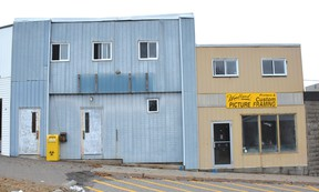 Photo by KEVIN McSHEFFREY/ THE STANDARD The City of Elliot Lake has awarded a contract to demolish these two buildings to Wendell Farquhar Trucking. One building was owned by the Knights of Columbus and the other was Woodland Printers.