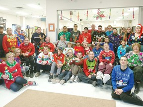 Nipawin Handi-works, pictured in their Christmas sweater group photo from 2019, was one of five organizations in the North East to benefit from a SaskTel employee giving program. File Photo.