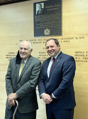 Past and the present: Formar Mayor Ron Irwin and current mayor Christian Provenzano unveil a plaque that commemmorates the new name of the city's waterfront Civic Centre. Irwin was mayor when the building first opened in 1974. POSTMEDIA