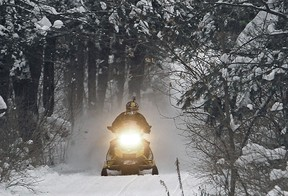 The Ontario Federation of Snowmobile Clubs (OFSC) is urging snowmobilers to avoid travelling outside of their local public health region until the province-wide lockdown ends. AP File Photo