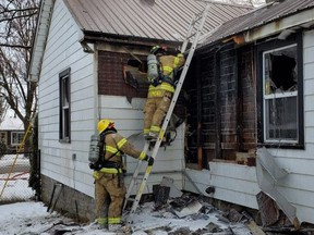 Volunteer firefighters in St. Marys respond to a residential fire on Queen Street East early Saturday morning.  Contributed photo