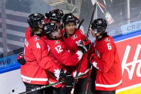 Bowen Byram (4), Jakob Pelletier (12), Jack Quinn (29), Quinton Byfield (19) and Jamie Drysdale (6) of Canada celebrate Byfield's goal against Switzerland during the 2021 IIHF World Junior Championship at Rogers Place on December 29, 2020 in Edmonton.