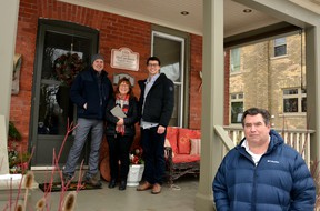 The Stratford-Perth branch of the Architectural Conservancy of Ontario presented its 300th historical plaque to the Bulbrook family at 191 Water Street in Stratford over Christmas. A gift for his parents from Hayden Bulbrook, the plaque commemorates Stratford Normal School English Master John McCutcheon, the first person to live in the home after it was built in 1908. Pictured from left are Darren, Sherry and Hayden Bulbrook, and Mark Yakabuski of the Architectural Conservancy of Ontario, Stratford-Perth branch. Galen Simmons/The Beacon Herald/Postmedia Network