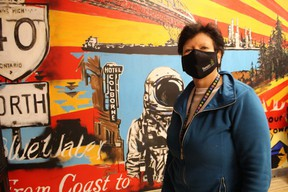 Owner Ellie Plata stands next to a mural inside Bluewater Joint, an authorized cannabis store that opened Monday on Murphy Road in Sarnia. It's the first licensed cannabis retail outlet in Sarnia.