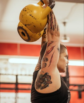 Michelle Munro of Round Two Fitness demonstrates a kettlebell workout.