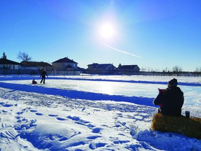 In conjunction with Leduc County, the New Sarepta Family Enrichment Association planned and organized the installation of a community outdoor rink in New Sarepta. On Saturday, Jan. 9 the community came together to shovel snow, prep the site and flood the liner. It is now open for the public to enjoy. (Supplied)