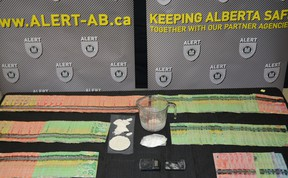 Cash and crack cocaine seized by Wood Buffalo RCMP and ALERT from a home in downtown Fort McMurray on Jan. 22, 2021. Supplied Image/ALERT