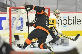 Philadelphia Flyers right wing Travis Konecny scores on Pittsburgh Penguins goaltender Tristan Jarry in the first period of a 5-2 Flyers win Friday in Philadelphia. Konecny scored his first NHL hat trick Friday. (Eric Hartline-USA TODAY Sports)