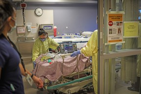 A COVID-19 patient at the intensive care unit at the Peter Lougheed Centre in Calgary on November 14, 2020. Photo by Leah Hennel/AHS
