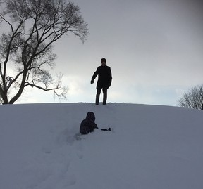 A father and his young daughter enjoy sledding in Dresden, Ontario in this file photograph from December 2017. Peter Epp/Chatham This Week