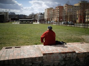 A woman sits at the Berlin Wall Memorial in Bernauer Srasse, a tourist hotspot of the German capital.