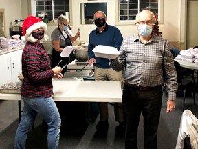 Getting turkey dinners ready to go, Jayne Curtis and Brian Brooks (rear), Pam Shea and Paul Scott helped prepare and package just over 140 meals with all the fixings to be delivered in Gananoque by the Lions Club on December 11.   Supplied by David Charles