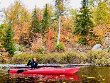 """There's no question, The Star's Mary Katherine Keown likes to paddle. She writes: """"My good buddy, Lynn, and I returned to Hess Lake at the end of September. I knew it would be amazing and it did not disappoint. The leaves were at peak colour, with hundreds of shades of yellow, orange and red. We found some very old survey lines and an excellent campsite at the far end of the lake. I'm told a railway went through the area at one time, and there was some mining activity. The lake we know today was created when a dam was built, flooding the bush. That likely accounts for a lot of the boulders and fallen logs that pepper Hess."""" See more of her photos on page B7."""