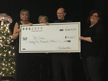 Jill Pessot, left, and Andrea Krats, far right, of Pet Save accept a $75,000 donation from Brenda and Dave Cranston that will go toward a new shelter being created in the old Wild At Heart building in Lively. Supplied