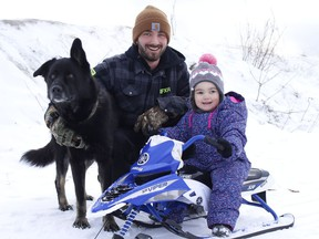 Jonah Lacasse, his daughter Sophia and their dog Dallas were getting some fresh air and exercise at the sliding hill east of Ross Avenue in Timmins on Thursday.  RICHA BHOSALE/The Daily Press