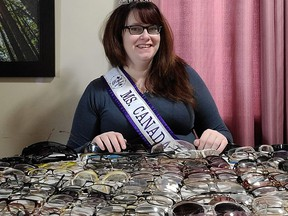 Sammy Barrette shows off the nearly two hundred pairs of glasses that will go to people who can't afford a pair..TP.jpg