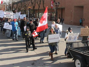Protesters opposed to COVID-19 restrictions marched through downtown Chatham on Nov. 21. (File photo/Postmedia Network)