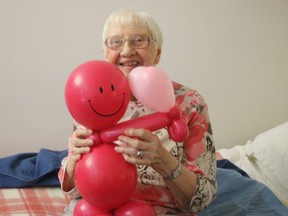 "Marie Cyr, who lives at Greenwood Court, is one of the many long-term care and retirement home residents in Stratford who have received a ""balloon buddy"" from ballon artist Melanie Bonaventura. Bonaventura, with the support of sponsors, is attempting to make one for every long-term care and retirment home resident in Stratford. (Contributed photo)"