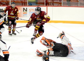 The Timmins Rock have traded forward Cameron Kosurko, shown here leaping to get out of the way of a point shot during an NOJHL game against the Hearst Lumberjacks at the McIntyre Arena on Dec. 13, to the OJHL's Wellington Dukes in exchange for a player development fee. Thursday is the deadline for Canadian Junior Hockey League franchises to complete transactions. THOMAS PERRY/THE DAILY PRESS