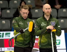Courtesy Curling Canada   Northern Ontario third Marc Kennedy (left) and skip Brad Jacobs discuss strategy at the 2020 Tim Hortons Brier in Kingston
