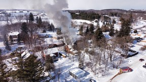 A fire in Paisley, Ont. photographed using a drone on Thursday, Feb. 11, 2021. (James Masters Photography)