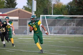 Tawal Kayumba runs the ball during the Fort Saskatchewan Sting's season opener against the Holy Trinity Trojans. The Fort Sting will be merging with Fort Minor Football for a shortened Spring Season. Postmedia.