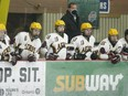 Athens players and coaches watch the action on the ice during an Aeros-Tikis scrimmage at the Brockville Memorial Centre in December. File photo/The Recorder and Times