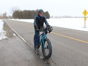 Inclement weather can't keep 78-year-old Walter Phillips from cycling more than 20 kilometres daily to stay physically fit and keep his diabetes in check. He is seen here Saturday cycling on Riverview Line just outside of Chatham. Ellwood Shreve/Chatham Daily News/Postmedia Network