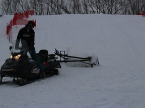 Brett Lauzon on the snowmobile, doing some late-afternoon grooming before Thursday night skiing and snowboarding under the lights at Big Ben. Photo Thursday, February 18, 2021, in Cornwall, Ont. Todd Hambleton/Cornwall Standard-Freeholder/Postmedia Network