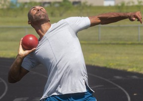 London olympian decathlete Damian Warner works on his glide during a little shot-put practice on Friday, July 17, 2020, with his coach Gar Leyshon. Warner is trying to maintain fitness, work on his strengths, improve weaknesses and stay healthy while waiting for the Olympics postponed until 2021. (Mike Hensen/The London Free Press)