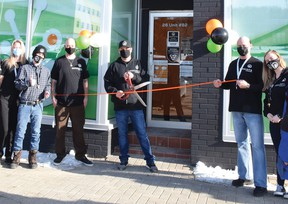 Photo by KEVIN McSHEFFREY/THE STANDARD The opening of the Sessions Cannabis Elliot Lake store was complete with a ribbon cutting ceremony. The owner of the franchise, Jason Hamilton, cut the ribbon to open the store, with a few of his staff in the photo.