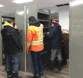 Photo supplied On Saturday, Feb. 13, Tim Derasp JC's Construction and eight of his employees, volunteered their time to help the Elliot Lake Emergency Food Bank move to its new location at 29 Columbia Walk.