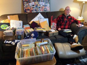 Jason Stewart of Pembroke is all smiles as he works his way through the hundreds of birthday cards that have been arriving since his mom Janet Baird put out a call for birthday wishes to help him celebrate his 50th birthday today, Feb. 3. Janet Baird